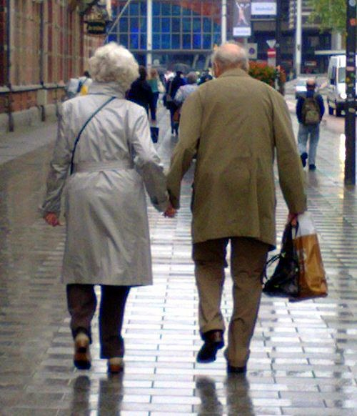 old couple holding hands 2