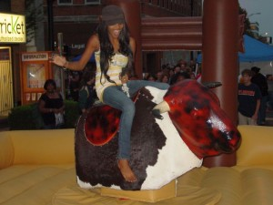 Mechanical Bull girl black hat