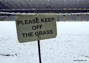 football in snow keep of grass sign
