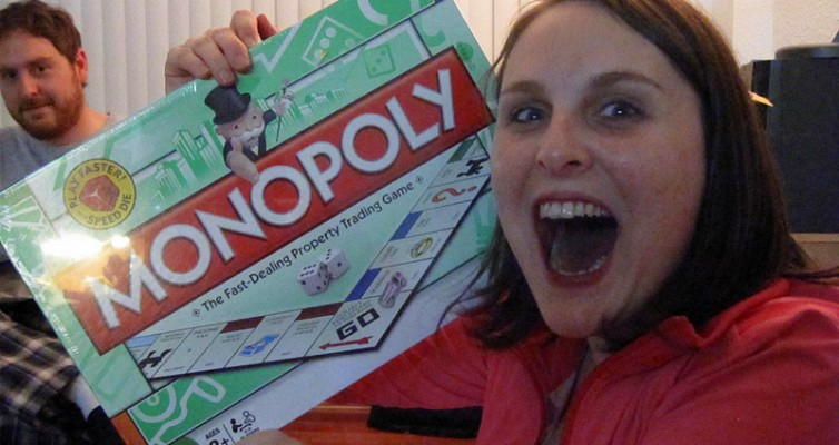 Monopoly game with excited girl