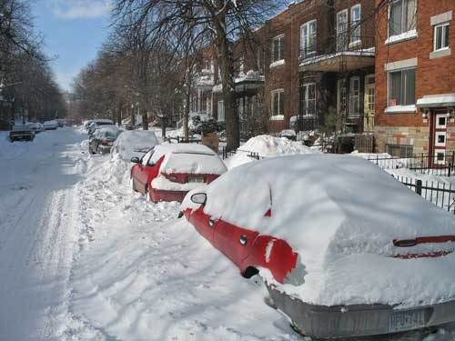 silver white winters melting ice man montreal snow street cars